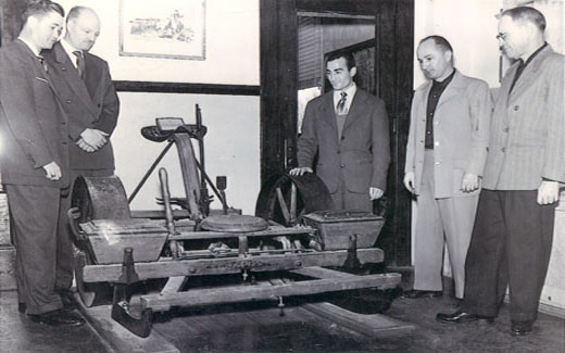 President Bob Foster views antique farming equipment once used on campus at the Northwest Farm.