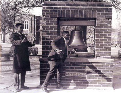 Students ring the Bell of '48 to celebrate the campus's first celebration of contributions and achievements made by black men and women to the university and the nation.  The event was called Black Week.