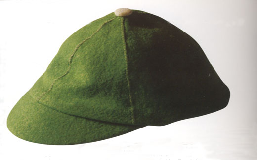 "The green beanie was worn by freshman students during the 1950s to indicate their ""new"" status.  Walk-Out Day signaled the end of having to wear the beanies."