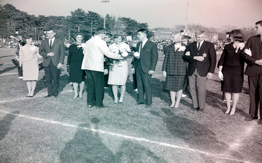 The 1962 Tower Homecoming Queen and Royal Court receive bouquets and corsages prior to start of the 归国 Football Game.