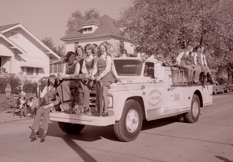 A group of Northwest sorority sisters ride on a Maryville fire truck during the 1973 归国 Parade to show their school spirit.