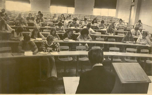 Students listen to Professor Dr. William Fleming in one of the lecture rooms in Colden Hall during the 1970s.